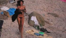 Rihanna seen partying on Shell Beach by Do Brasil beach bar